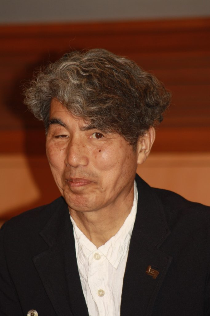 Filmmaker and Professor Kohei Ando answers questions at the conference